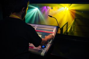 Someone operating a lighting desk