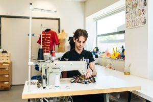 Technician using a sewing machine