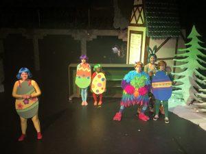 Actors in egg costumes