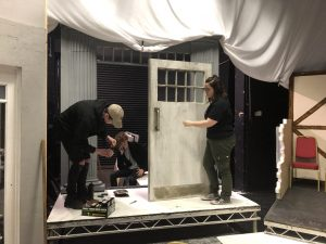 Technicians working on the set for London Road