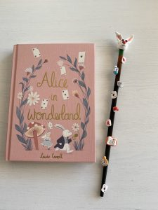wand decorated with Alice in Wonderland details